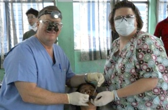 Dentist and team member treating dental patient