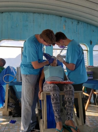 Patient receiving dental treatment at community event