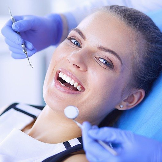 Woman smiling during dental checkup