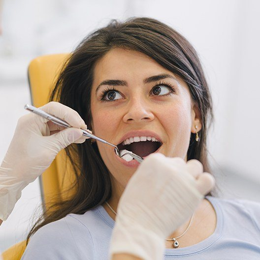 Woman receiving root canal therapy