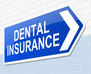 Dental insurance sign on a wall.